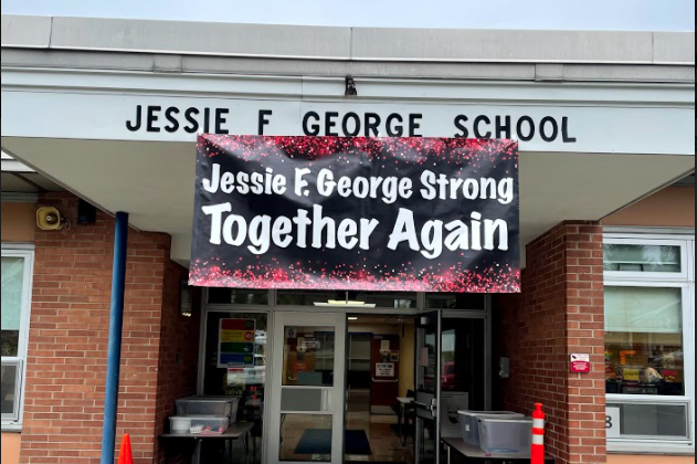 "School sign ""Jessie F. George School Together Again"""