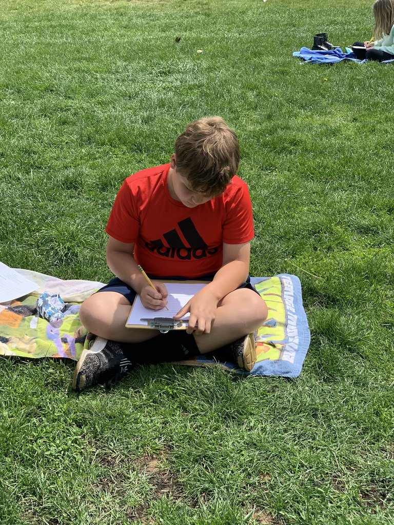 boy completing reading checklist