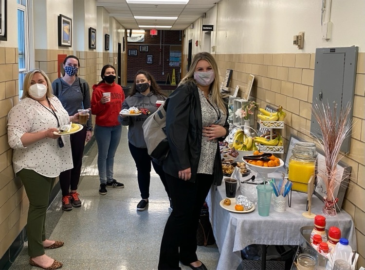 teachers and staff enjoying breakfast