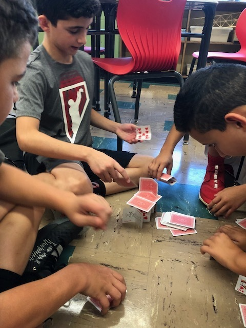 Group building a card castle