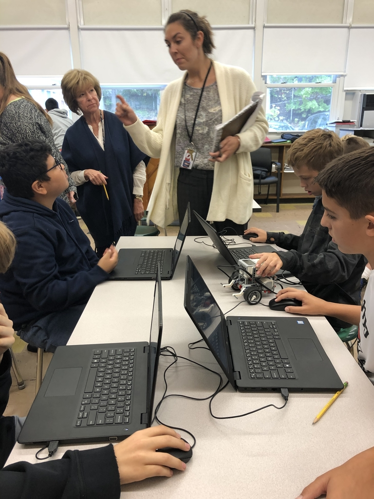 Robotics students collaborationg with Ms. Chernati.