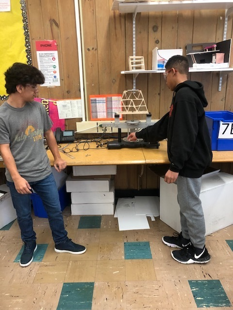 WRMS Engineering students testing the strength of their custom bridges.